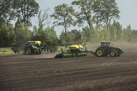7290R Tractor pulling a 1795 Planter