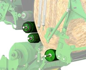 Driven bale chamber rolls rotate crops immediately