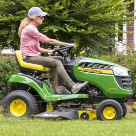 E100 Tractor mowing