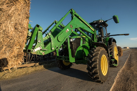 700M Loader working with 7R 210 Tractor