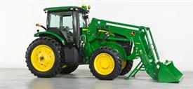Tractor ready to be backed away from loader