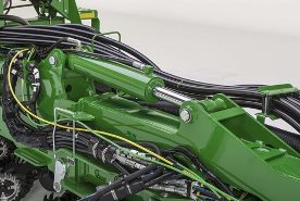 Hydraulic cylinder mounted on planter wings for frame weight distribution