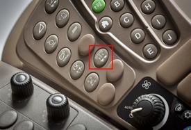 Icône du bouton de réduction de la vitesse des courroies latérales