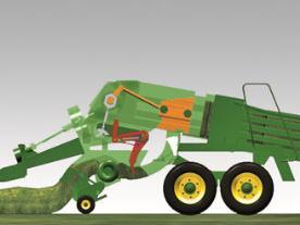 1. Le bras du système d'alimentation amène les récoltes dans la chambre de précompression.
