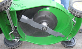 Underside of a mower with mulch blade and plug