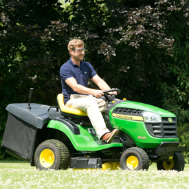 X135R Tractor mowing lawn