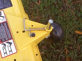 Spring-loaded mower wheel height-adjusting pin