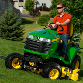 X710 Tractor mowing with 152-cm (60-in.) HC Mower Deck