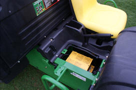 Battery charger located under passenger seat