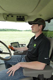Application operator using AutoTrac Vision following row crops