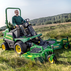1570 Front Mower mowing tall grass