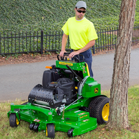 Operator trimming around tree with QuikTrak™ 652M