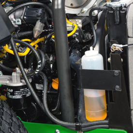 Coolant reserve tank and oil filter