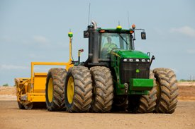 Precision leveling farm land with iGrade™ leveling system