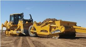 John Deere crawler pushes an ejector scraper