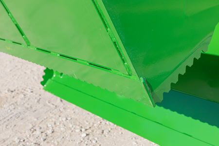 Serrated edges enhance overall bucket performance