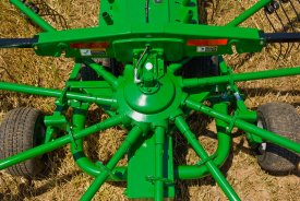 Cam-action tine arms for efficient drying time