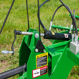 Adjust pitch of rake tines with hand crank