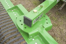 Adjustable tine beam