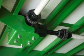 Power take-off (PTO) shaft runs underneath the implement