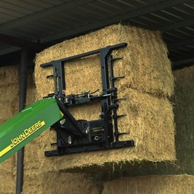 MJ4060 holds bales for placement and stacking