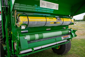 Balers with the B-Wrap attachment can switch between net wrap or B-Wrap