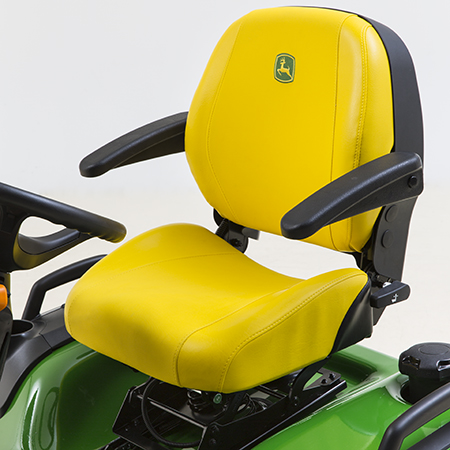 Two-piece adjustable seat with armrests, four-bar suspension, and seat slide