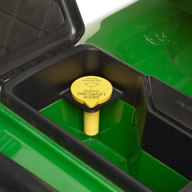 Deck-level gauge stored in tractor toolbox