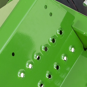 Foot peg mounting holes