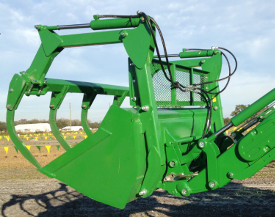 Five-tine bale grapple with screen installed on 85–in. (2150 mm) bucket on H-Series Loader