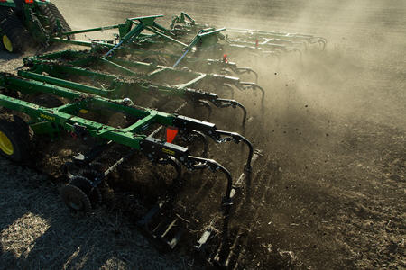 Rolling baskets distribute residue and reduce clods
