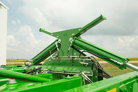 Adjust hydraulic pressure to wing-fold cylinders to improve soil penetration