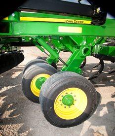 Wheels located in-between ripper shanks