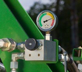 Hydraulic rolling basket down pressure valve