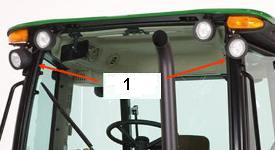 Auxiliary work light kit (1) on front of a 5M cab