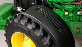 Deluxe, pivoting front fender on a 7R Series Tractor