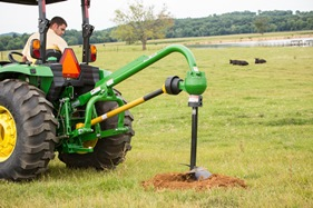4R Series Tractor equipped with 3-point hitch downforce kit and post hole digger