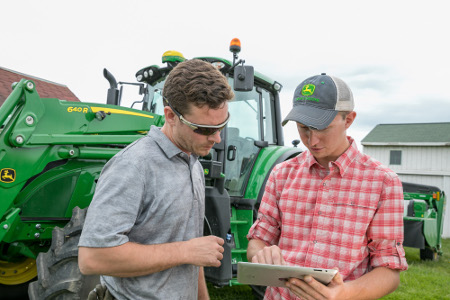 John Deere 6155M with StarFire™ 6000 Receiver and tablet with JDLink