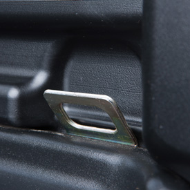 Integrated tie-down point in cargo box bed
