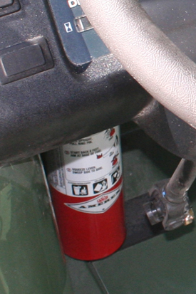 Fire extinguisher - located under dash (left side)