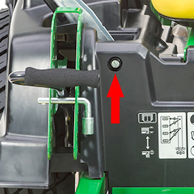 Cut-height pin doubles as a tool for tracking adjustment (arrow)
