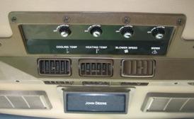 Aire acondicionado, controles de limpiaparabrisas y ventilador