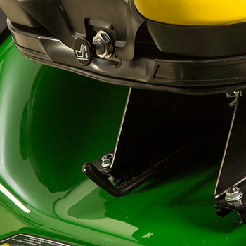 Palanca de ajuste longitudinal del asiento e interruptor de presencia del operador