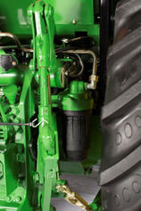 Hydraulic oil filter (behind 3-point hitch)
