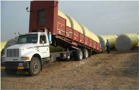 Unloading round modules in gin yard