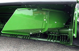 Windrow forming shields (rear curtain raised for visibility)
