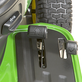 Side-by-side foot pedals and cruise control lever