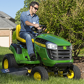 E120 Tractor mowing