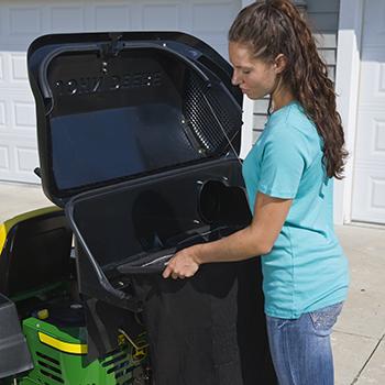 Removing bag from 6.5-bu (230-L) hopper