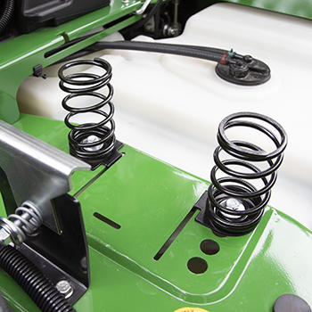 Seat springs in forward position for lighter operators